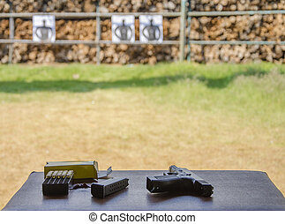 Outdoor gun shooting of target range.