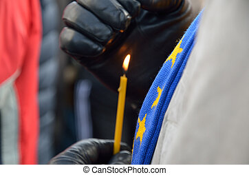 Candle burning in the male hands Ukrainian hope - A thin wax...