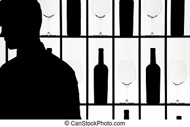 Silouette of a waiter against bottle and glasses