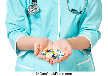 Pills in hand - Cropped image of female doctor holding pills...