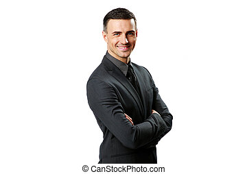 Portrait of a happy businessman with arms folded isolated on...