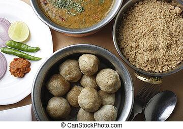 Dal Bati - Dumplings Cooked in Lentil