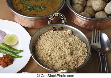 Churma is a popular delicacy served with baatis and dal -...