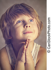 boy at prayer - Photo boy at prayer