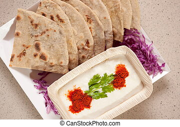 Tandoori Roti is an Indian unleavened bread which is usually...