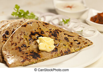 Hot delicious paratha with ghee