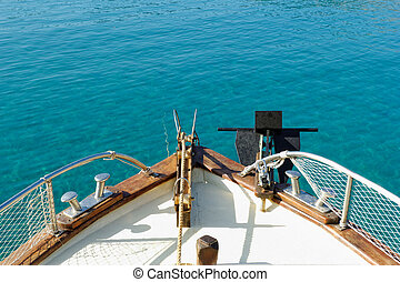 Rostrum - Photo of a ship on the turquoise sea