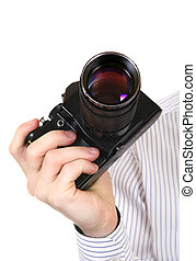 Old Camera in a Hand Isolated on the White Background