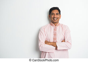 traditional indian male casual portrait with plain...