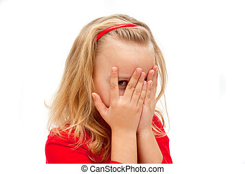 girl spies - child covered his face spying