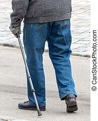man with walking stick - a man with a walking stick to help...