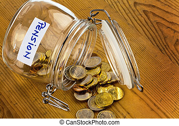 jar with coins inscription retirement pension - gold coins...