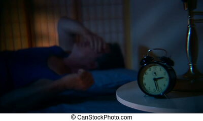 can\'t sleep - Man tossing and turning and having a restless...