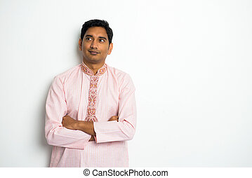 traditional indian male thinking with plain background and...