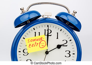 time changeover to summer time - an alarm clock with a note...