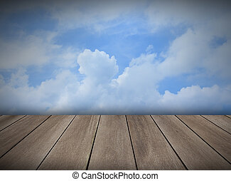 wood floor with blue sky white clouds background