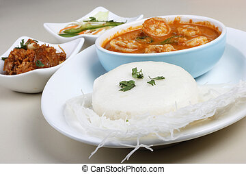 Idli - Steamed rice cakes from South India Goan idli is made...