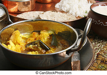 Cauliflower Brinjal Curry is made with fresh vegetables and...