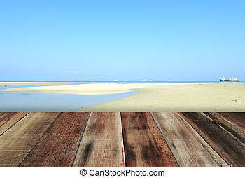 wood floor with blue sky white sand beach background