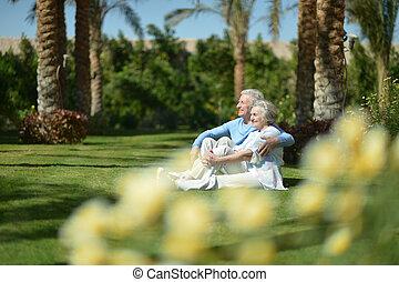Senior couple at hotel resort - Senior couple sitting on...