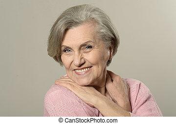 Elderly woman portrait - Senior woman portrait on a brown...