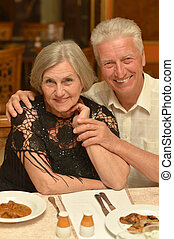Senior couple at restaurant - Senior couple having a dinner...