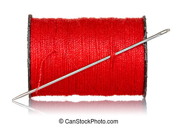 Spool of red thread with needle isolated on white background