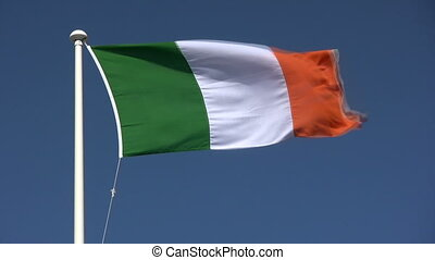 The Irish flag blowing in the wind.