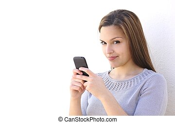 Beautiful woman texting on a smartphone and looking at...