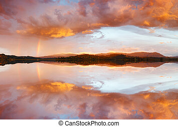 Reflection of colorful sunset - Reflection of dramatic and...
