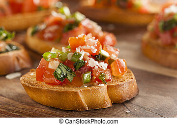 Homemade Italian Bruschetta Appetizer with Basil and...