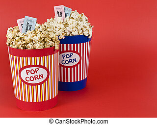 Four for the movies - Two popcorn buckets over a red...