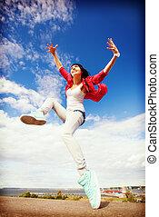 beautiful dancing girl jumping - sport, dancing and urban...
