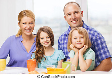 happy family with two kids with having breakfast - food,...