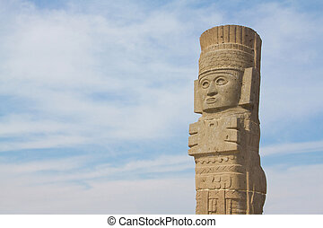 Toltec sculpture and clouds in Tula Mexico