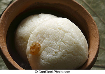 Rasagolla is a syrupy sweet. - Rasgolla is a syrupy dessert...