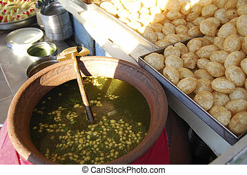 Pani puri is a popular street snack - Panipuri is a hollow,...