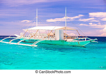 Big catamaran in turquoise open  sea near Bohol island
