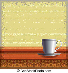Small coffee cup standing at the wooden table with ornaments...