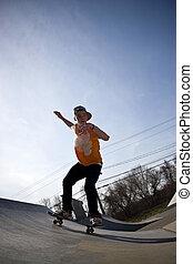 Skateboarder at the Skate Park