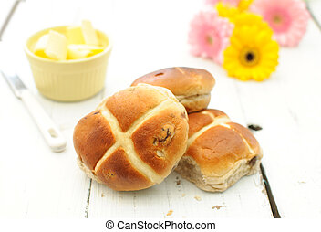 Hot cross buns - Freshly baked hot cross buns on a kitchen...