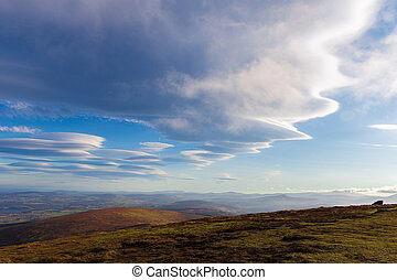 Lenticular clouds forming in Wicklow Mountains