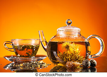 Blooming tea served on glass - Teapot and cup with blooming...