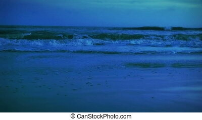 (1005) Evening Surf at Beach - Beach surf at dusk. Dominant...