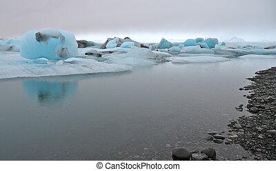 Blue icebergs, Jokulsarlon lagoon - Blue icebergs floating...