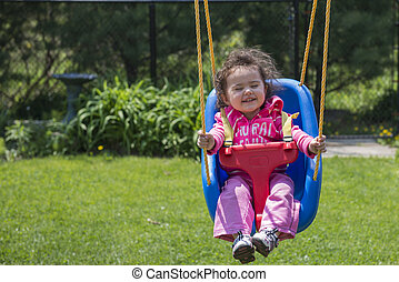 Little girl having fun in Swing - Little girl having fun...