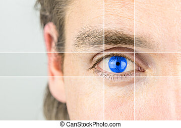 Young man with a vivid blue eye with parallel lines drawing...