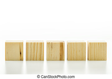 Row of five blank wooden blocks on a white background