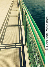 Ferry Boat Deck - Ferry boat deck with railing and shadow,...