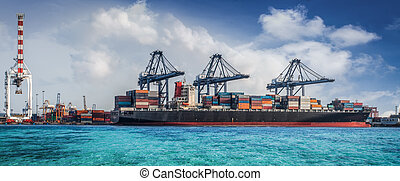 Container Cargo freight ship with working crane loading...